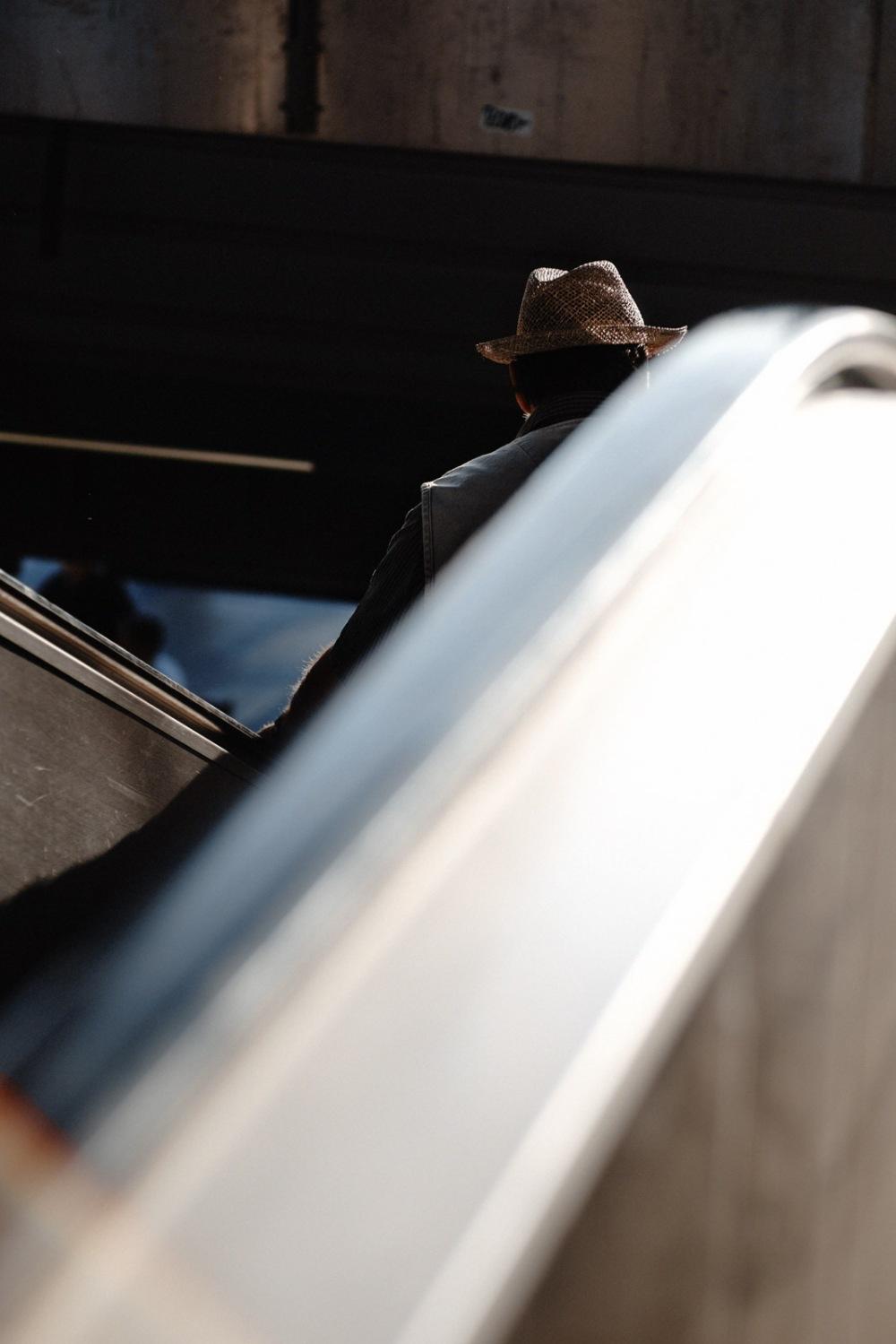 escalator with hat